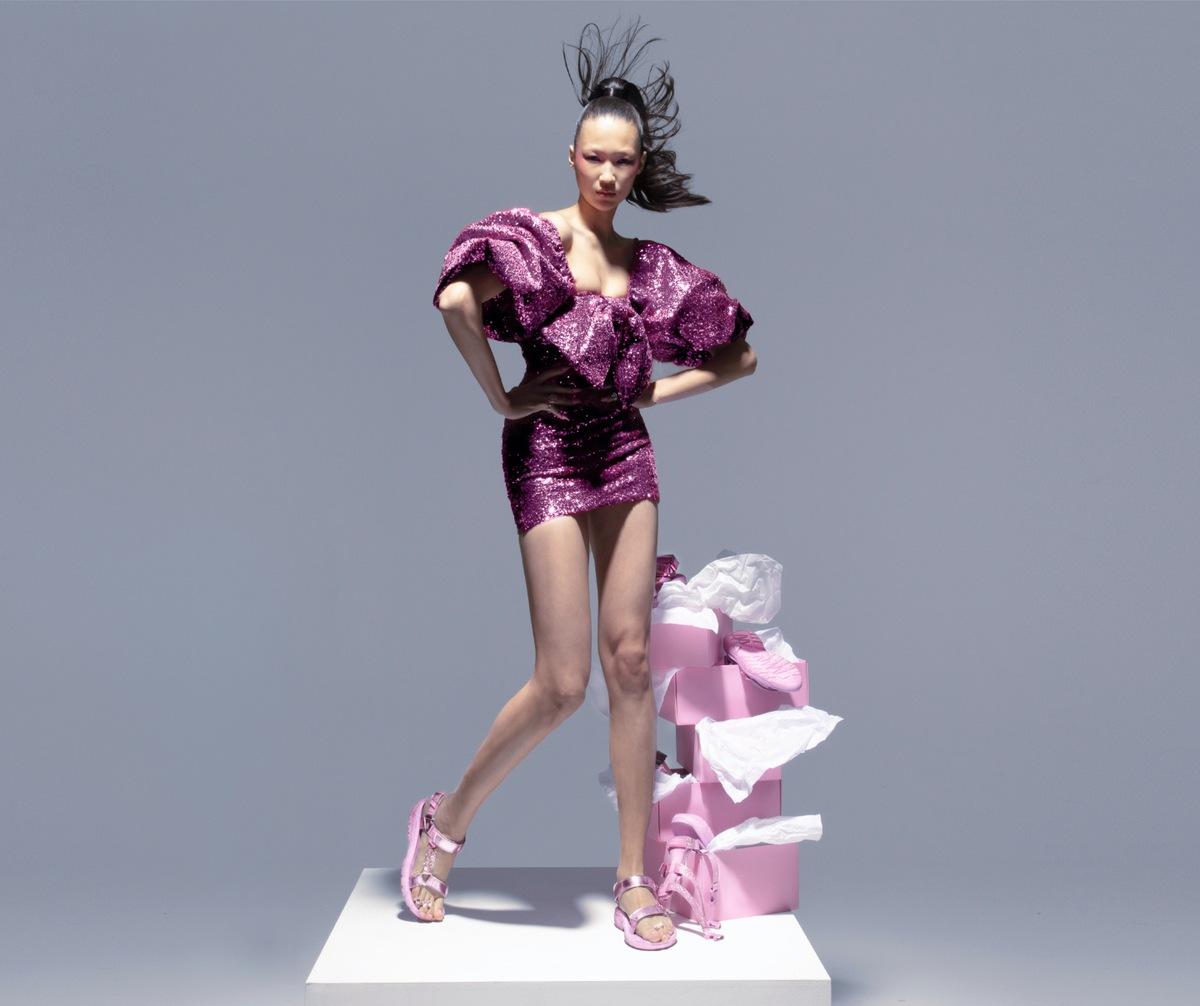 Main image women posing with Christian Cowan Hurricane XLT2 CC Pink shoe